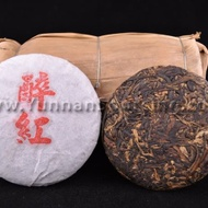 "2011 ""Drunk on Red"" Sun-dried Jingnu Black Tea Mini-Cake from Yunnan Sourcing"