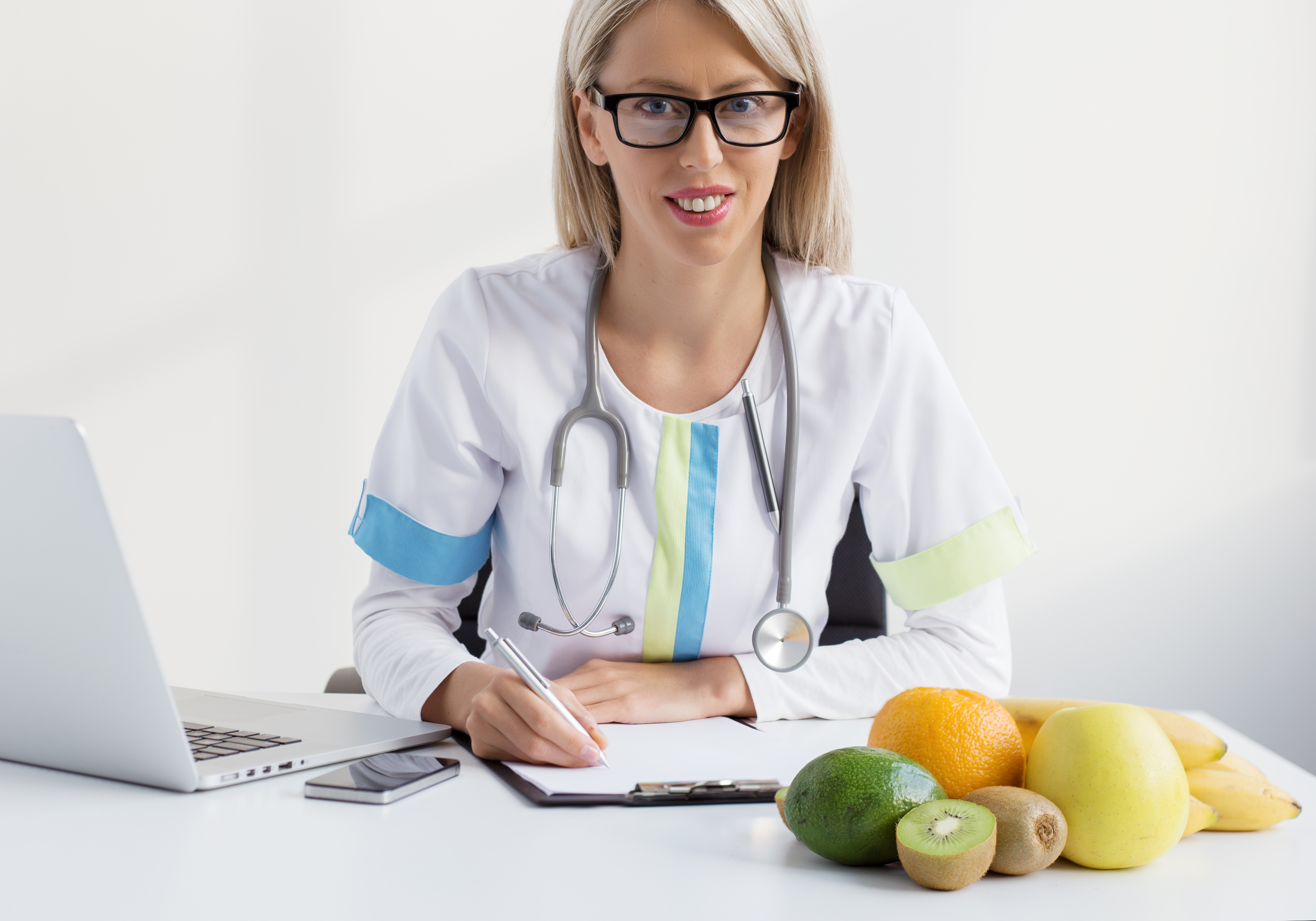 dr and plate of healthy food