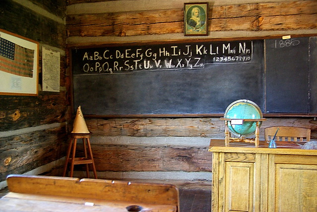 historic school room with dunce hat and world globe