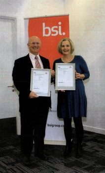 Roy Taylor, MD, collecting the certificates