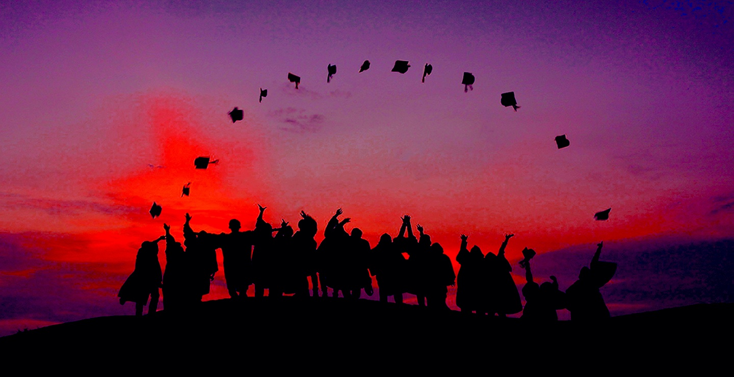 College Graduates Throwing Cap in the Air | Best College Aid Background Image