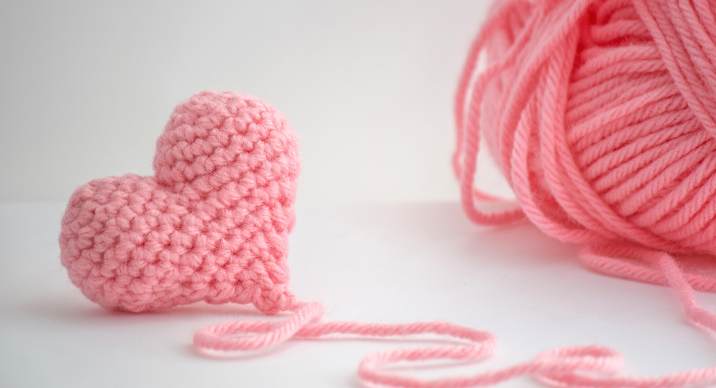Pink Crochet Heart with a string of pink yarn