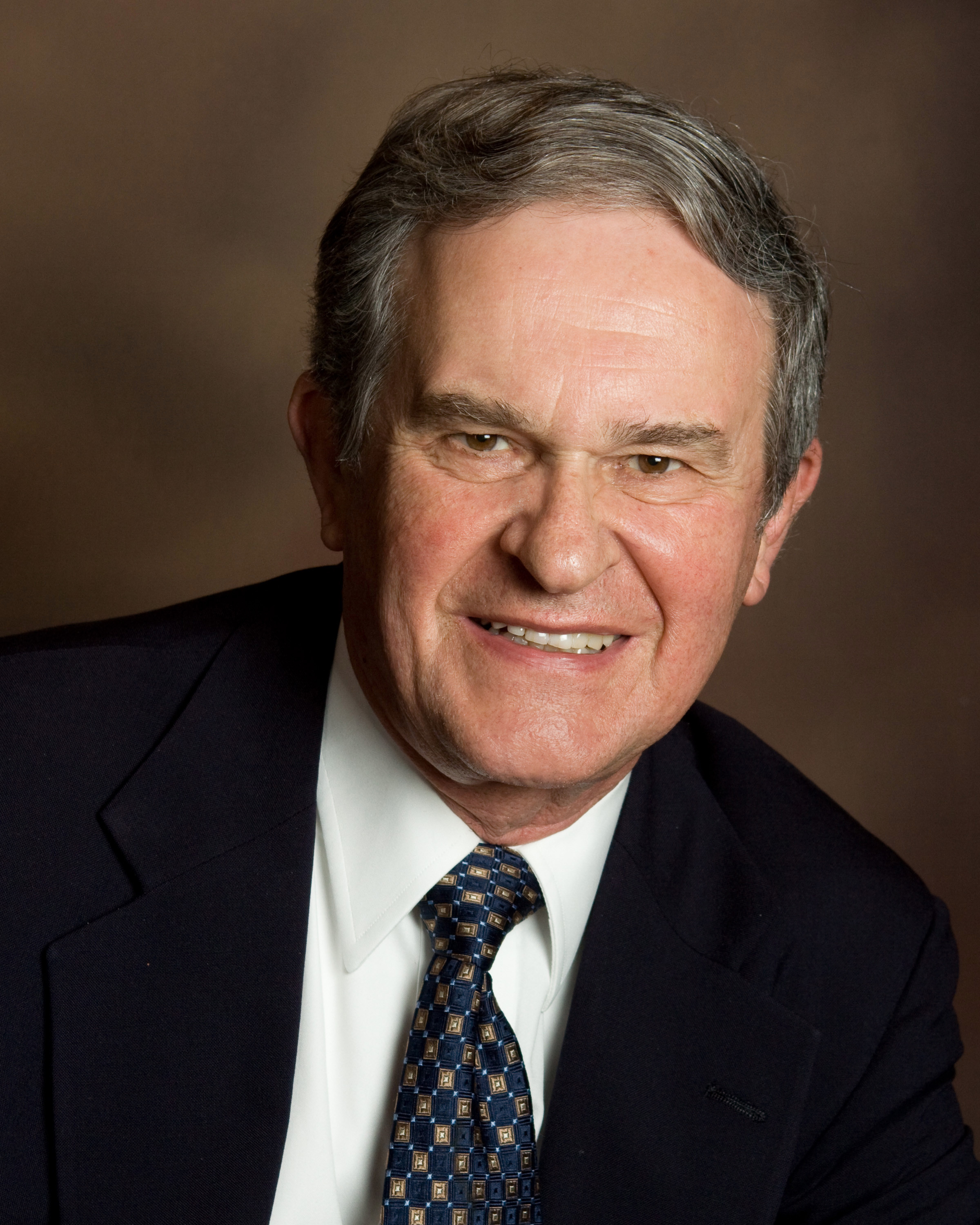 Portrait of Marvin Blickenstaff smiling in a suit