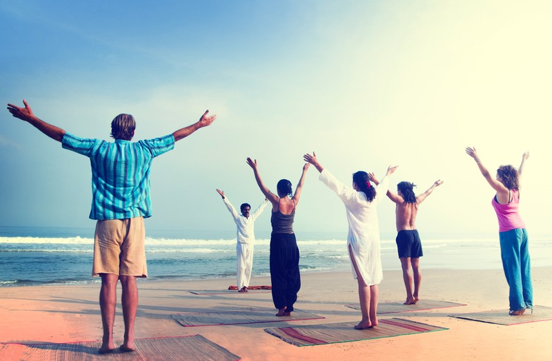 Upward Facing Hands (Urdva Hastasana) on beach