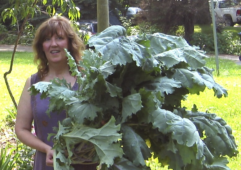 Debby with the largest single kale she has ever grown