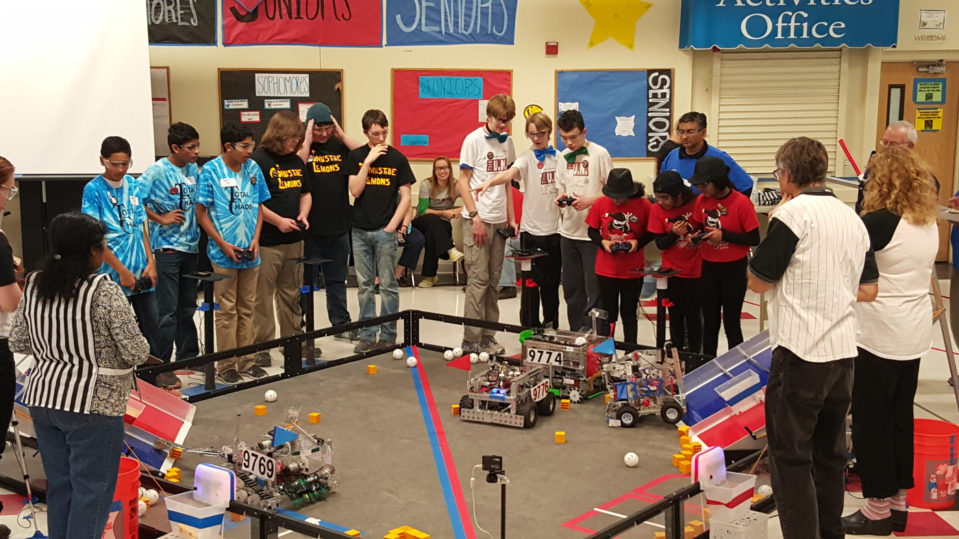 The Nano Ninjas robot in action, competing in an alliance against two other allied teams