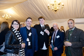 carl-anderson-centre-and-peter-benyon-second-left-with-fellow-guests-at-the-celebration-receptionjpg
