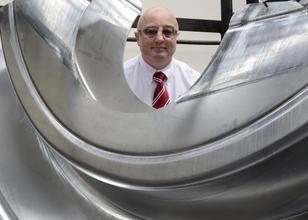 Alloy Heat Treatment's Sales Director Ian Perks with heat treated aerospace component
