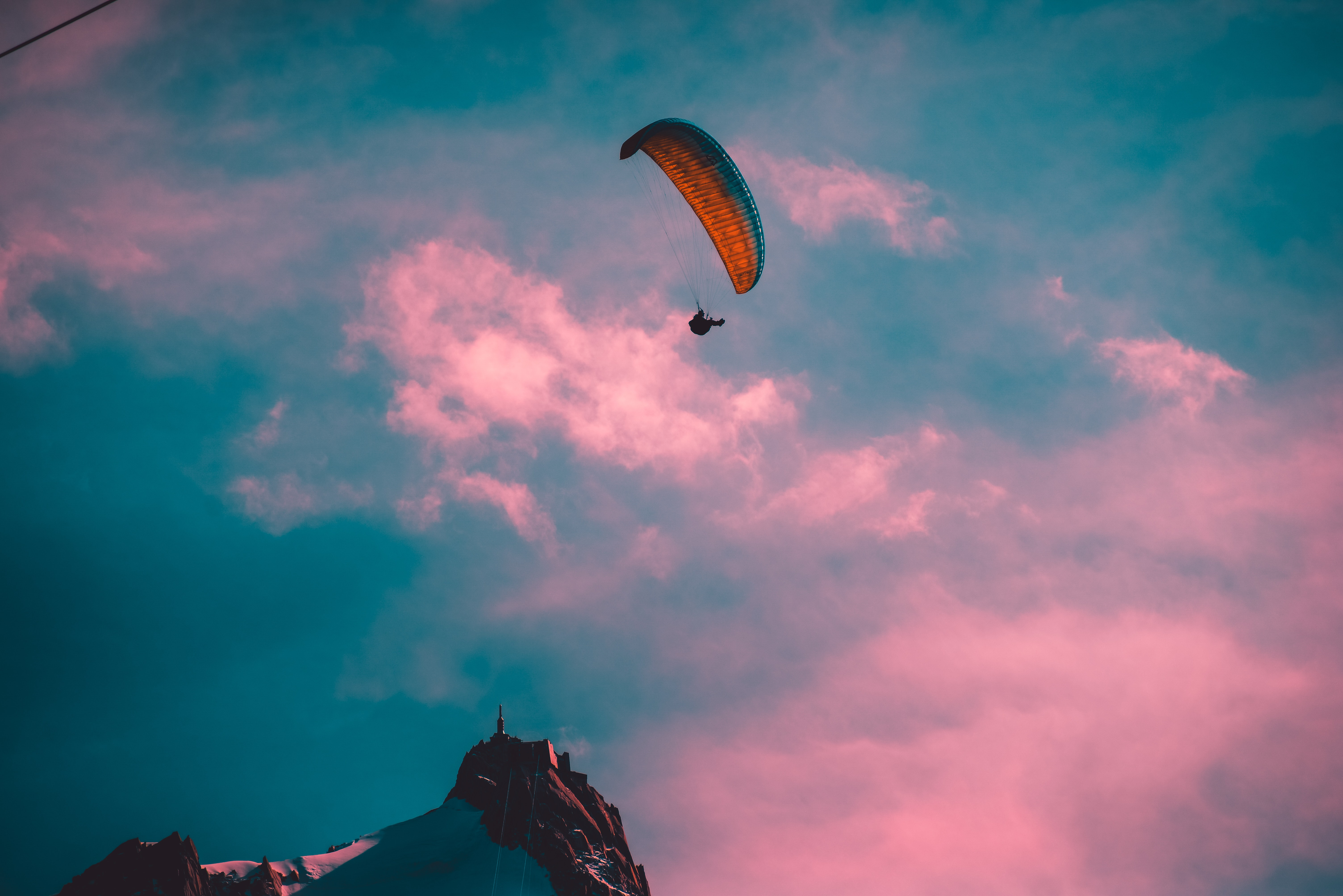 A paraglider in the air - Goal Success Program