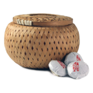 Changning Yiyou Organic Puerh mini tea cakes from Tea Cargo www.teacargo.co.uk