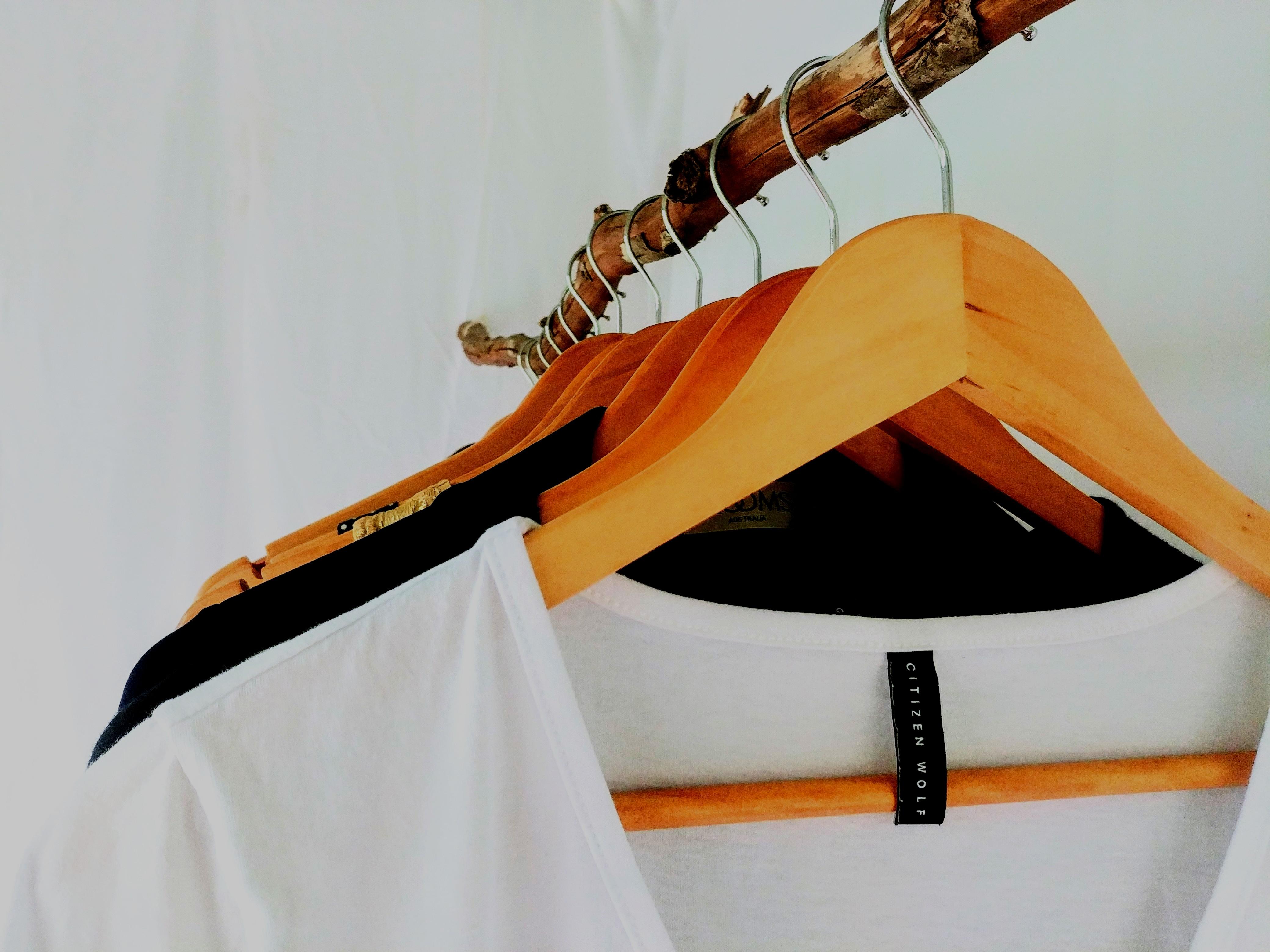 Clothing hanging in wardrobe; effortless style, basics
