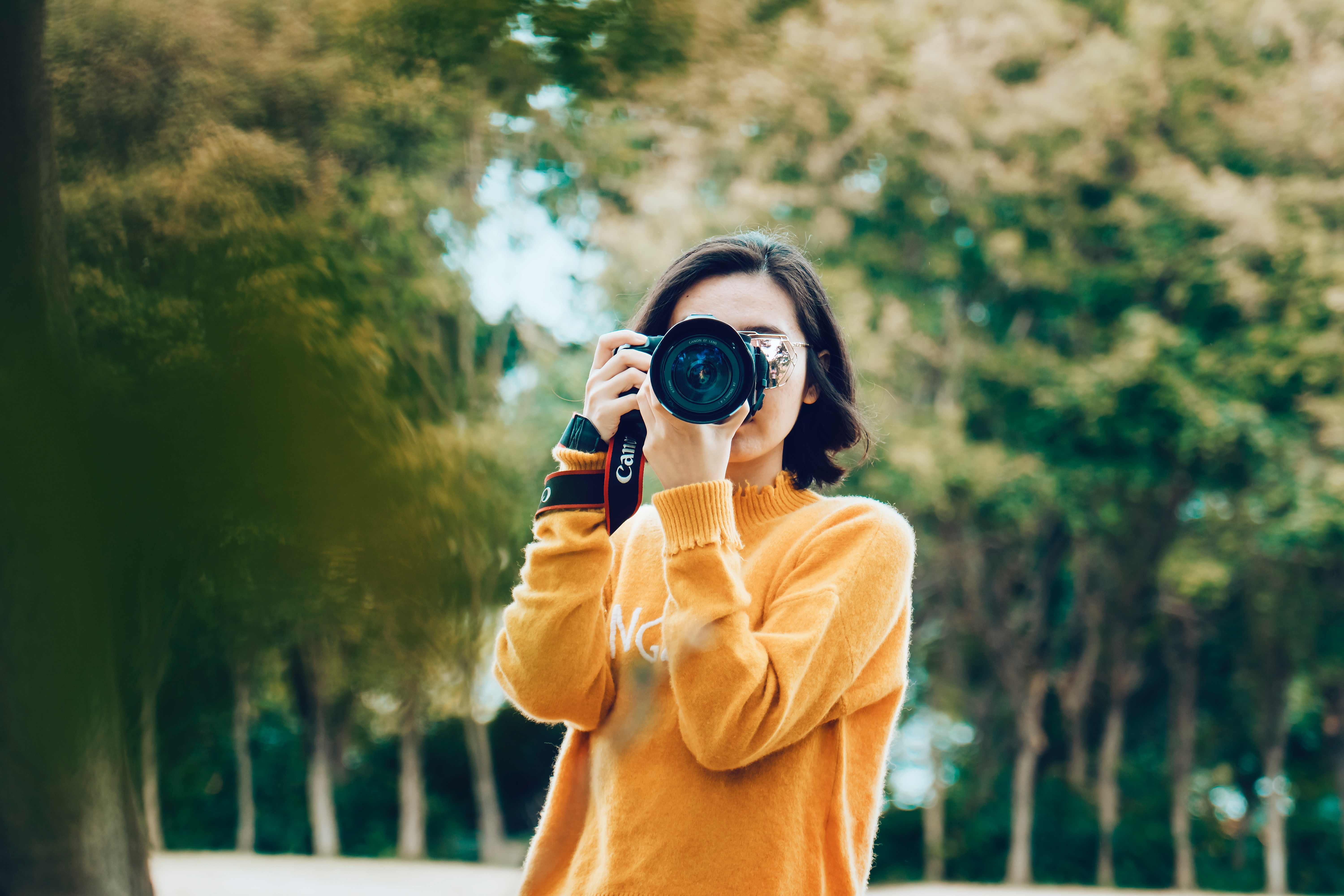 Woman holding camera taking a photograph