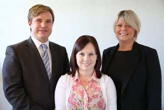 Partners, James Rousell (left) and Susannah Griffiths (right) with Rebecca Clark (centre)