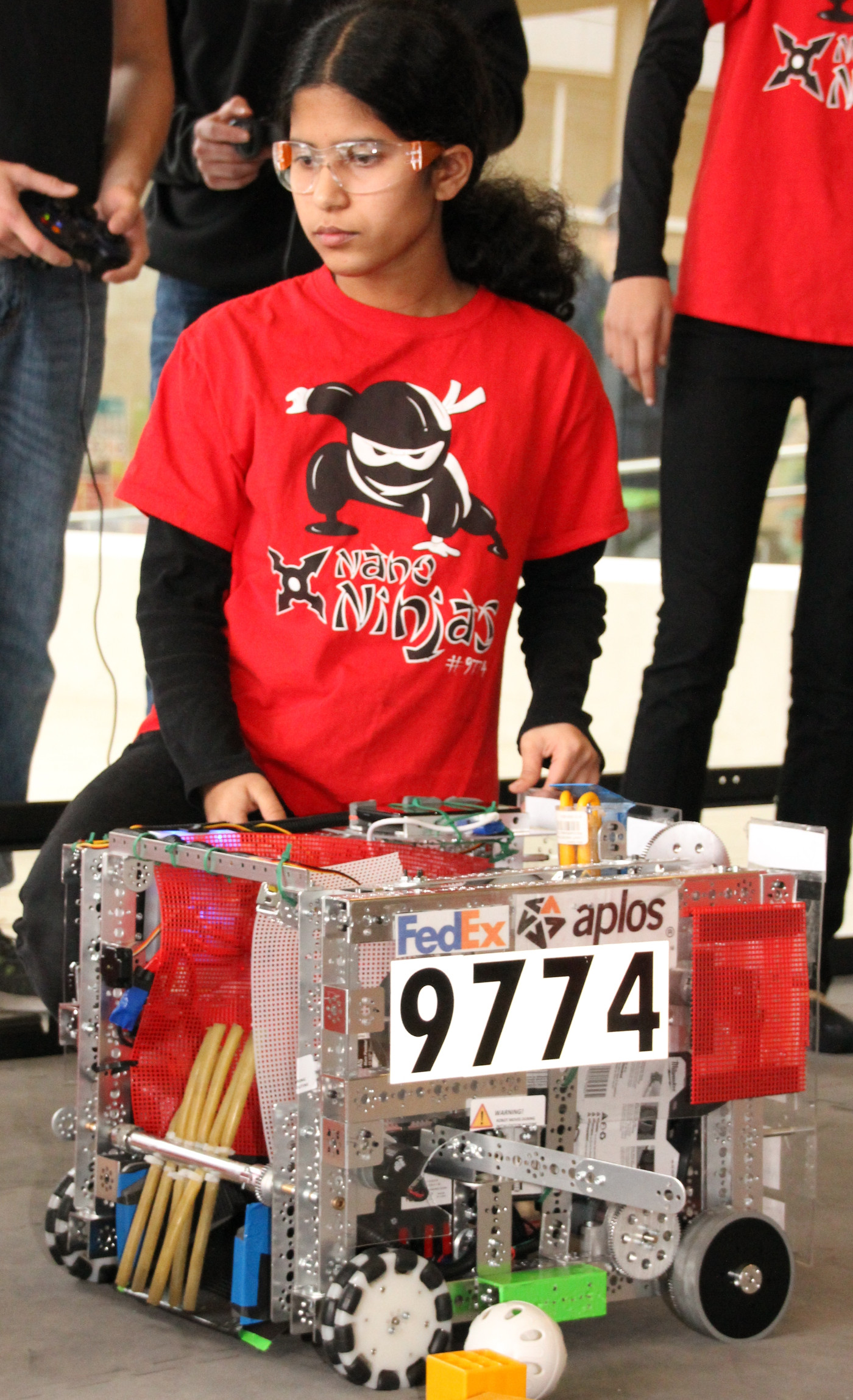 The Nano Ninjas demo their robot during the qualifier!