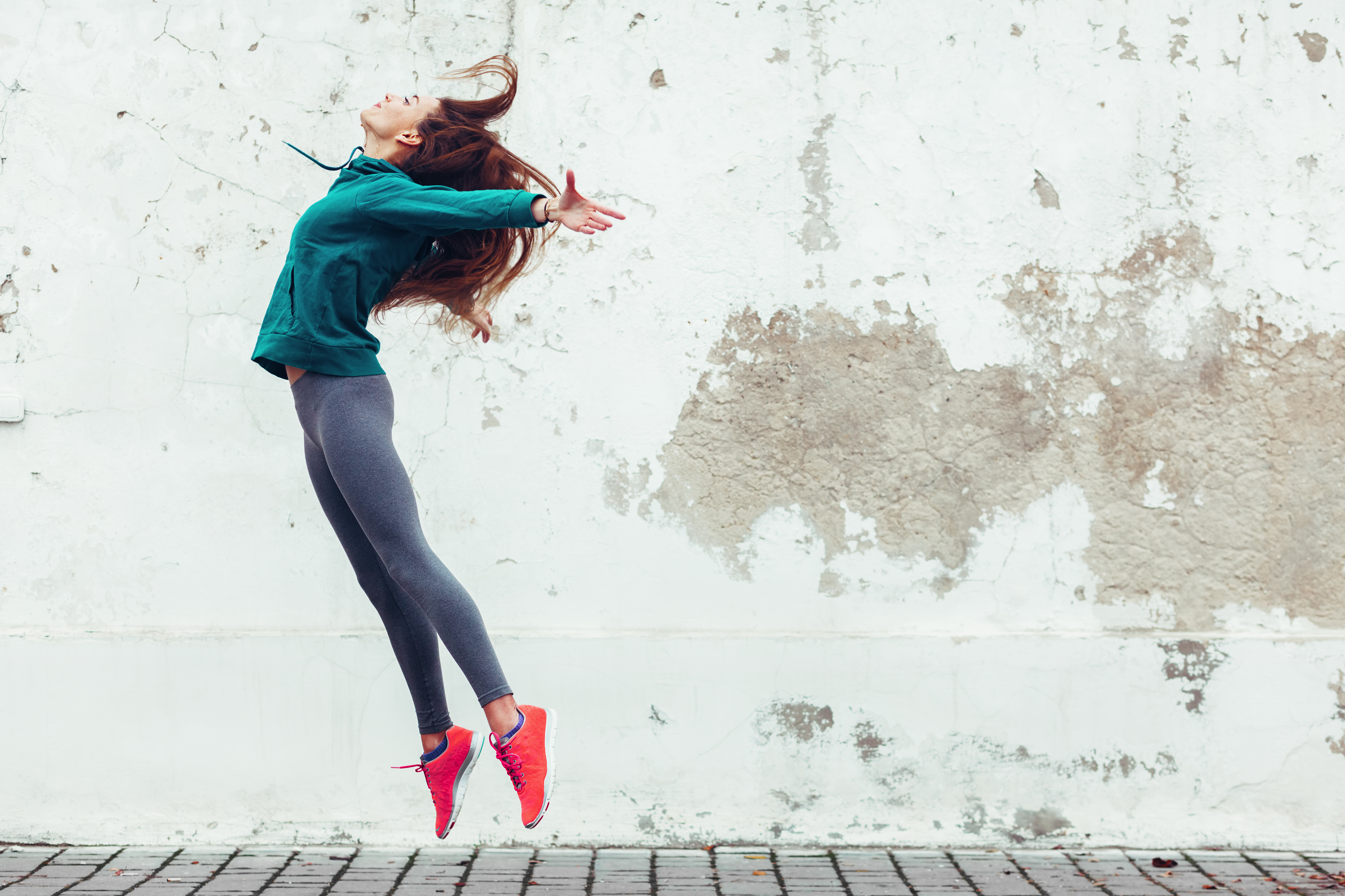 woman in sports clothes jumping