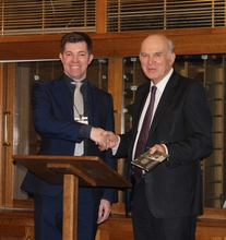 MIM's Jason Pitt presenting Vince Cable with a commemorative Sir Winston Churchill coin
