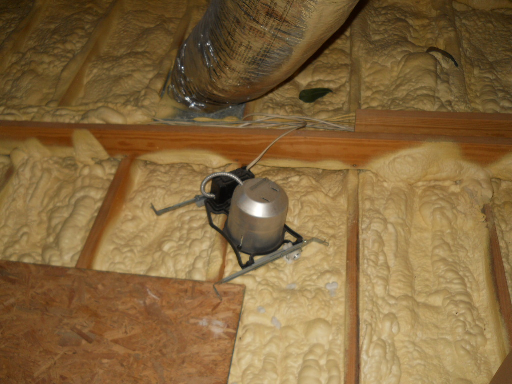 Spray foam insulation viewed in an attic during a home inspection