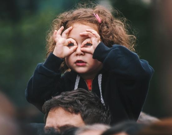 Girl looking through binoculars image