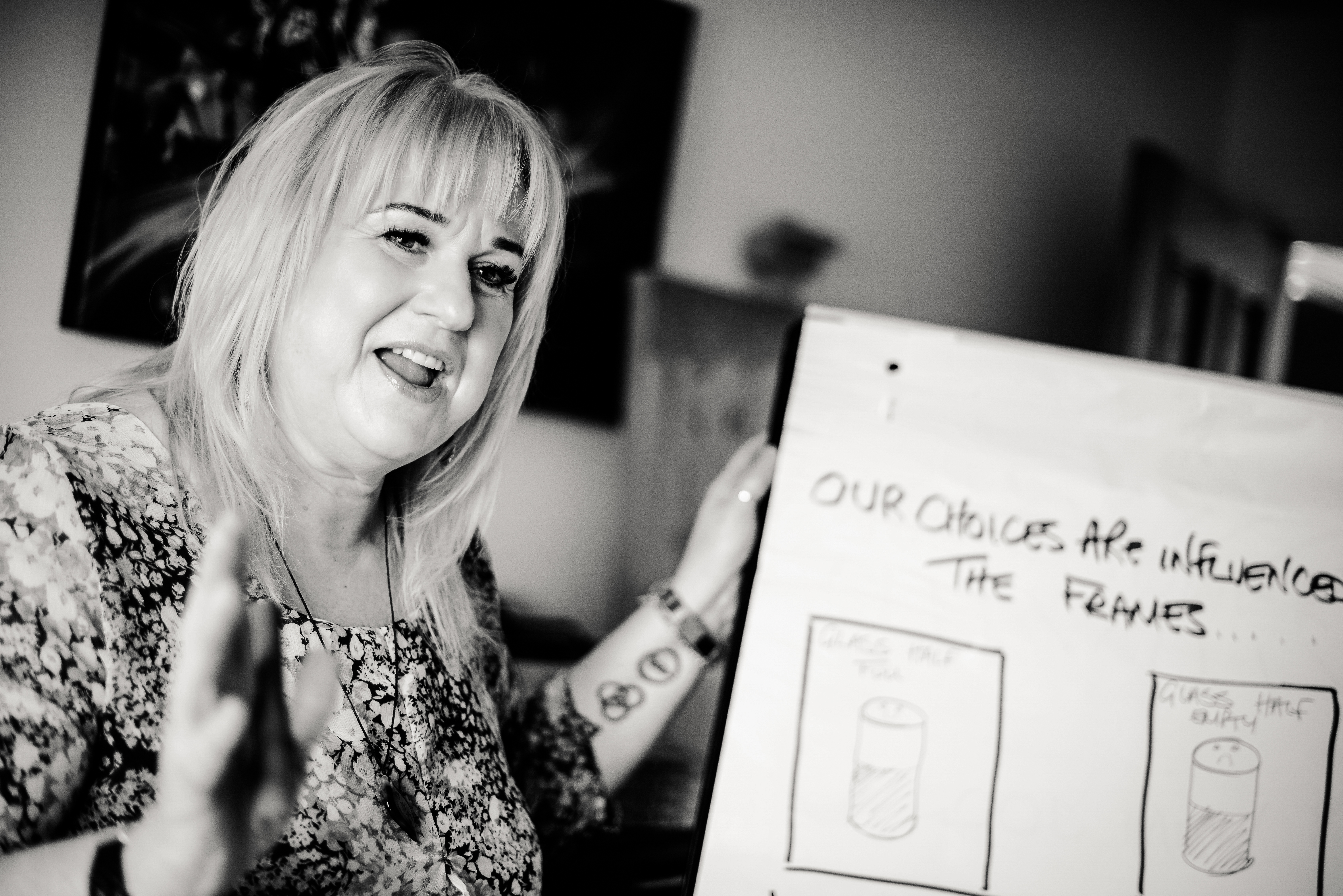 picture of a woman talking next to a flip chart