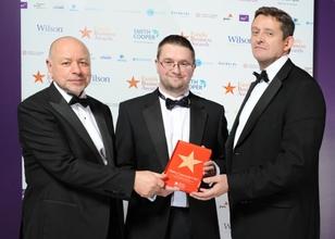 Richard Chinnock receiving his award
