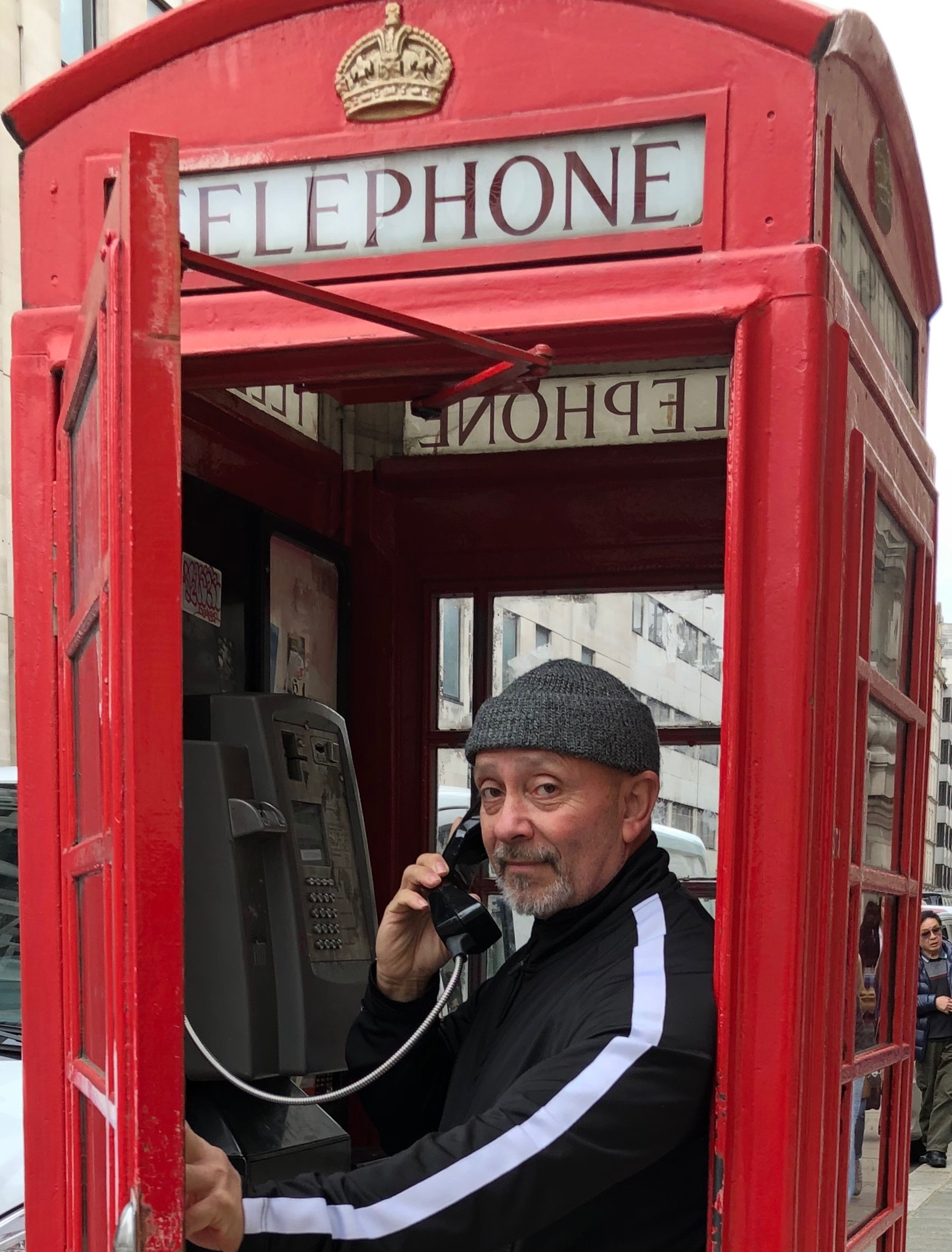 Laz at a London Phone Booth