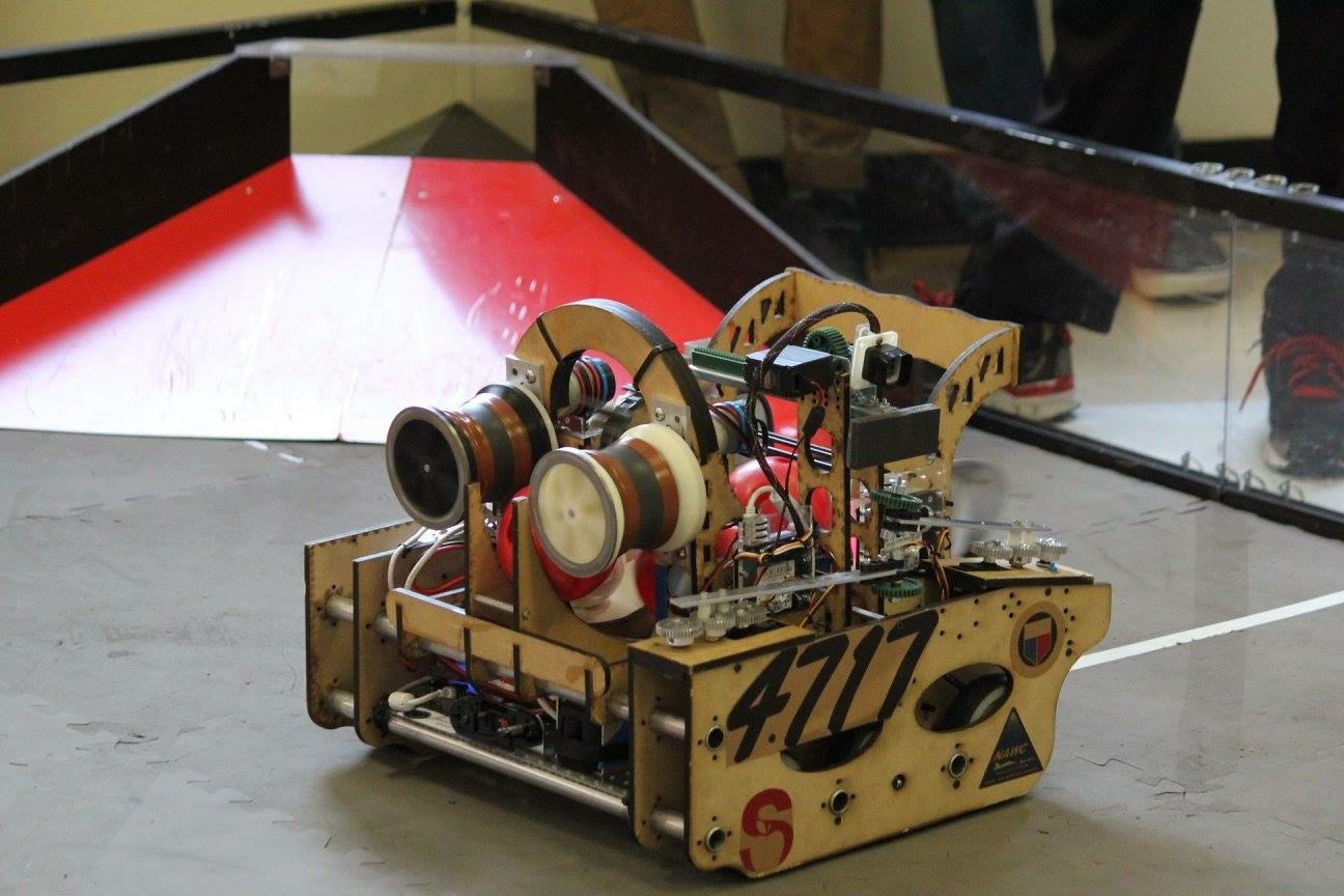 A photograph of Timbur the robot in action during a competition