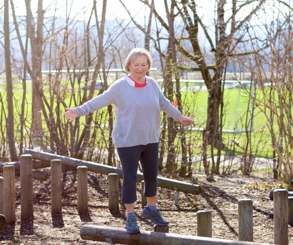 Woman balances on a log