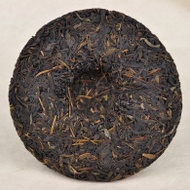 "2012  ""Autumn Yi Wu Purple Tea"" Raw Pu-erh tea cake from Yunnan Sourcing"