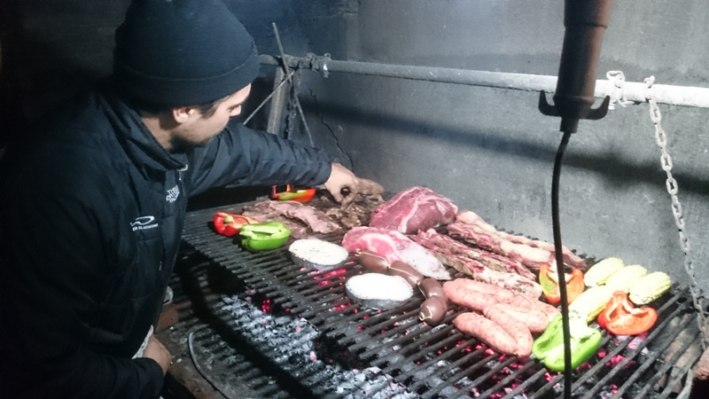 Marcos working his asado magic