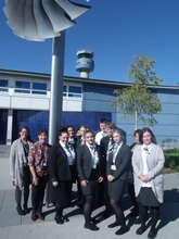 Derby College students, lecturers and EMA staff in front of the main terminal at East Midlands Airport