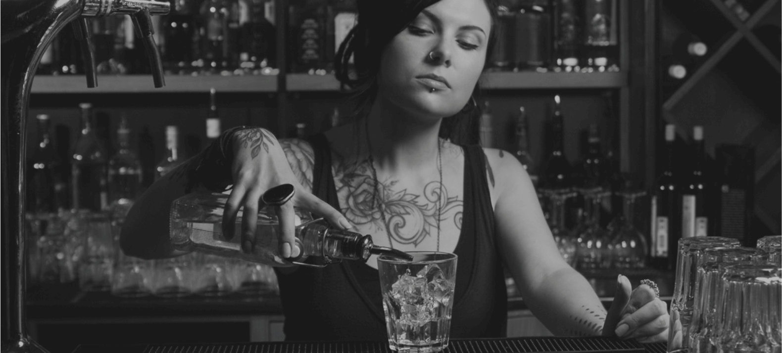 bartender pouring a drink black and white