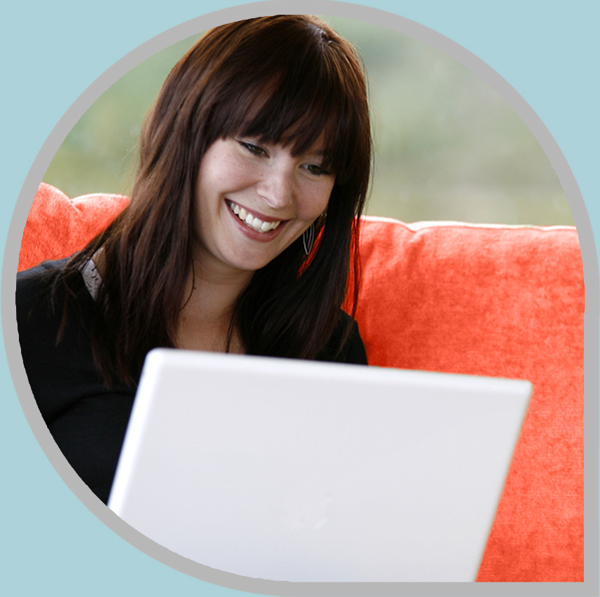 Woman smiling at her computer screen