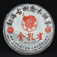 2006 Xinghai Golden Peacock Ripe Puerh Tea Cake from Yunnan Sourcing