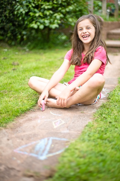 My friend Bea's daughter playing with chalk in the garden