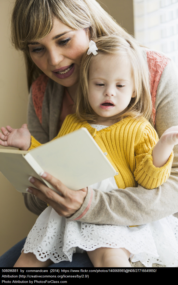 Child with Down syndrome reading speech therapy
