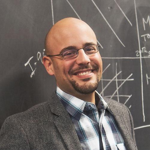 Professor Alfredo Garcia Mora PhD standing in front of a chalkboard at Princeton University