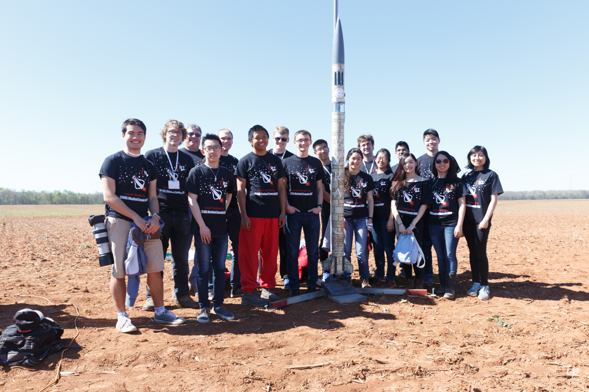 Cornell Rocketry Team poses with their rocket, Ezra.