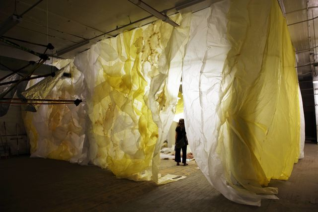 image: Seen here myself cherishing the last moments before deinstalling my installation, 2014. Installation, 18' x 20' x 50'