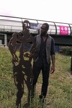 Ledley King alongside his statue