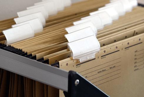 pile of brown folders