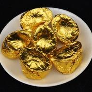"""2012 Lincang """"Gold Ingot"""" Ripe Pu-erh tea mini tuo from Yunnan Sourcing"""