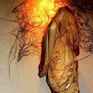 image: Drawing, hand-stitched adornment and photo created by artist, 2009.