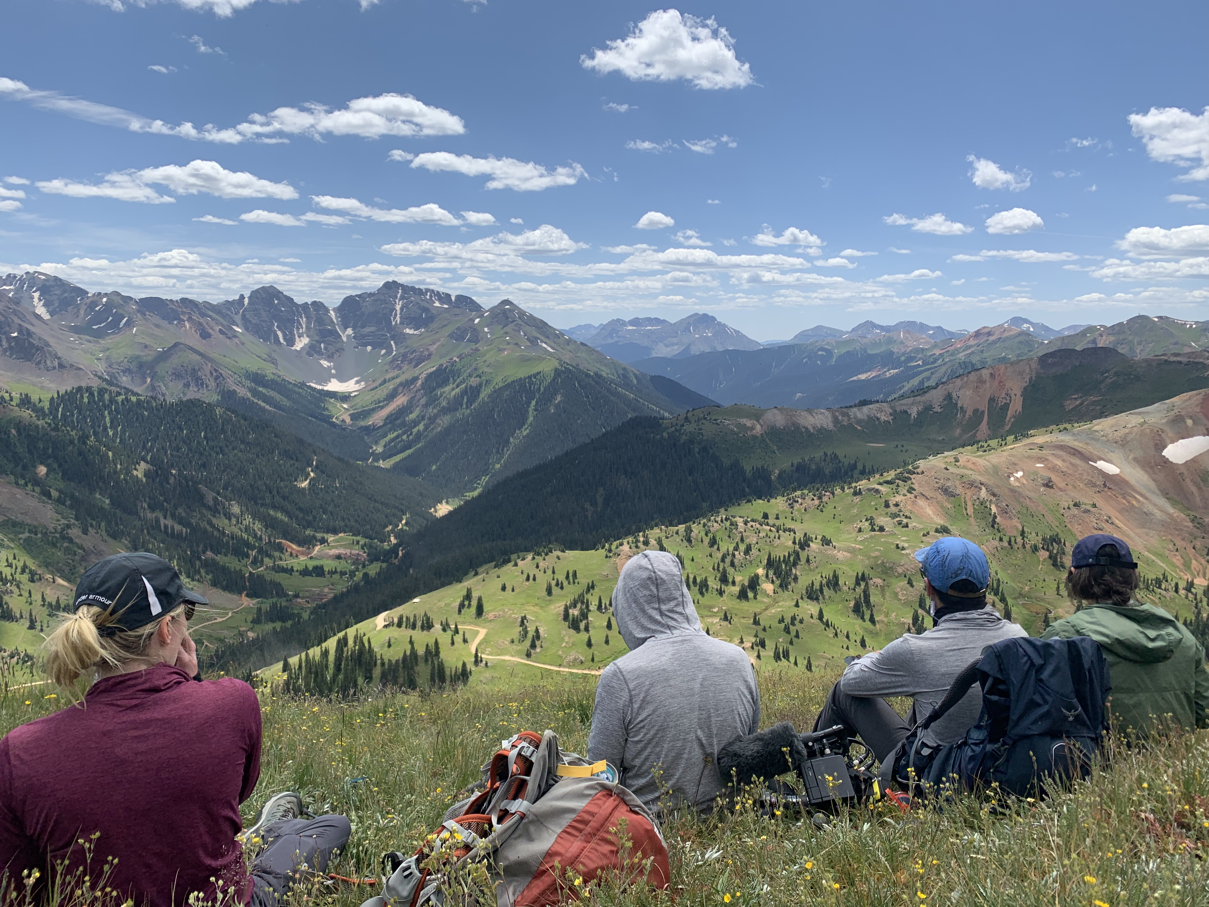 Students sitting on a mountain top
