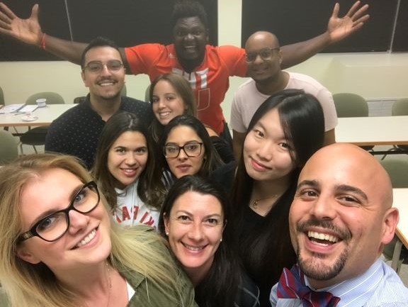 Professor Alfredo Garcia Mora with African American university students and diverse students in classroom
