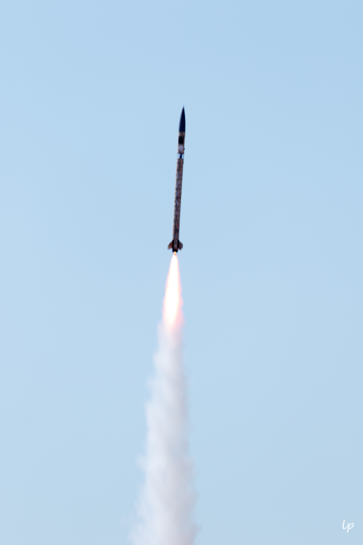 Photo of Cornell Rocketry Team's rocket, Ezra, in flight.