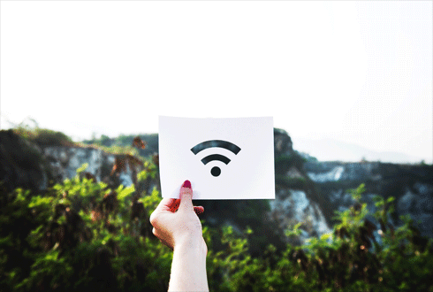 person hand holding a paper with wifi logo