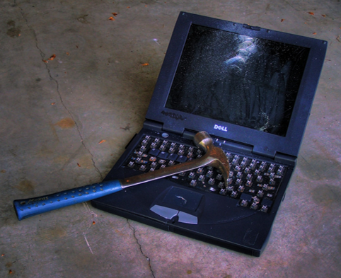 A hammer and laptop