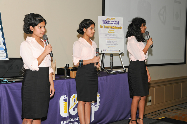 Photograph showing <em>The Three Musketeeretts</em> presenting their solution for the LIVE eCYBERMISSION National Showcase