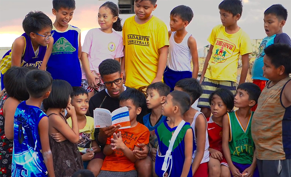 Dante Lee reading a Tagalog book to Filipino children