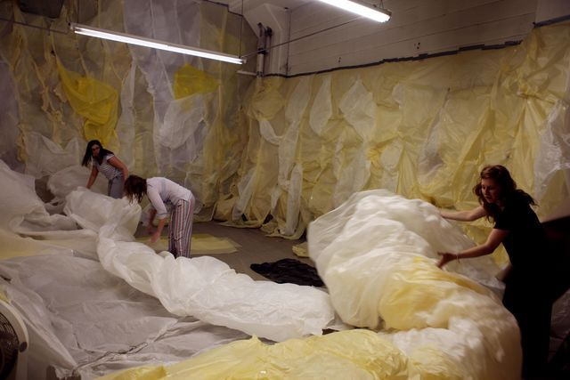 image: My Mother, Sister and myself rolling up the unfinished walls of the installation.